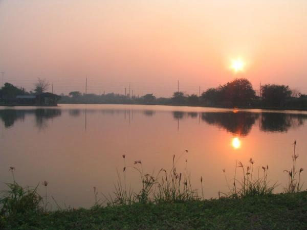The sun sets over IT Monster predator Lake in Ratchaburi.