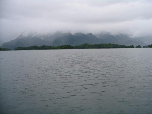 Storm clouds gather above Khao Laem Dam in Kanchanaburi province.